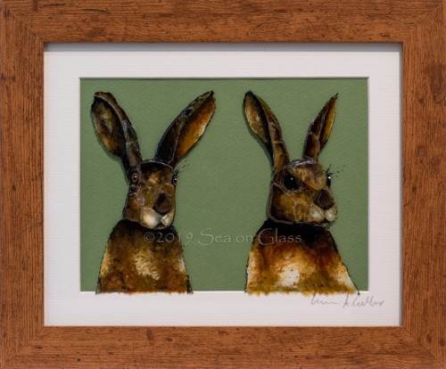 Double Hares on Brown in larger brown frame